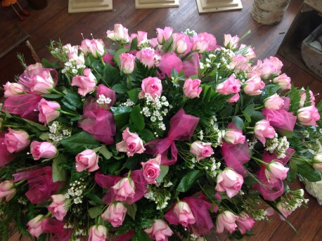 Pink roses coffin spray